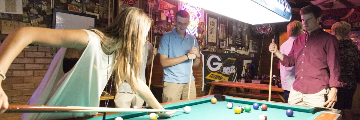 Time Out Tavern Dallas patrons playing pool
